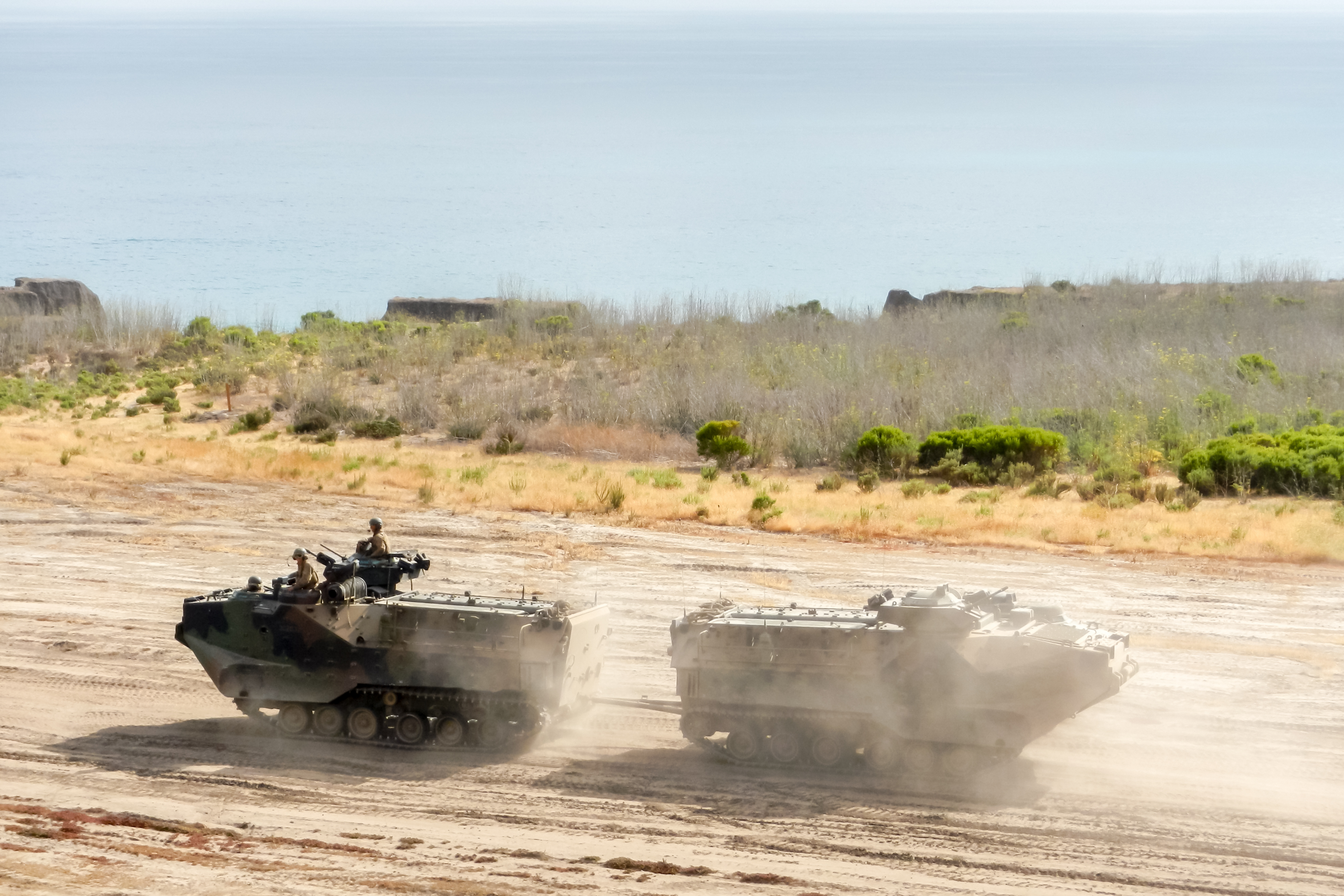 Military Vehicles in the desert, representing contract jobs in the Middle East