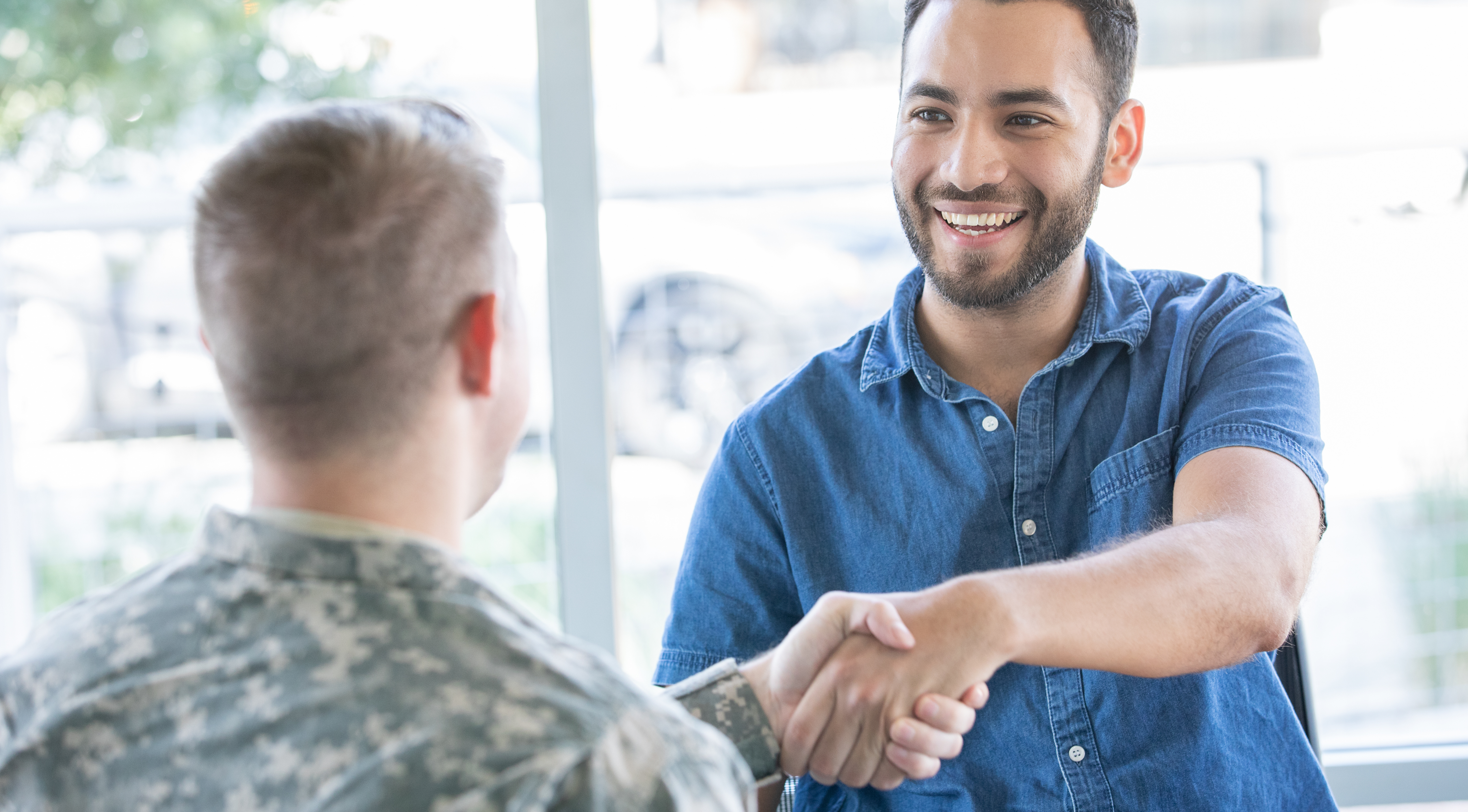 Two men in an interview to represent job hunting support M&E can provide