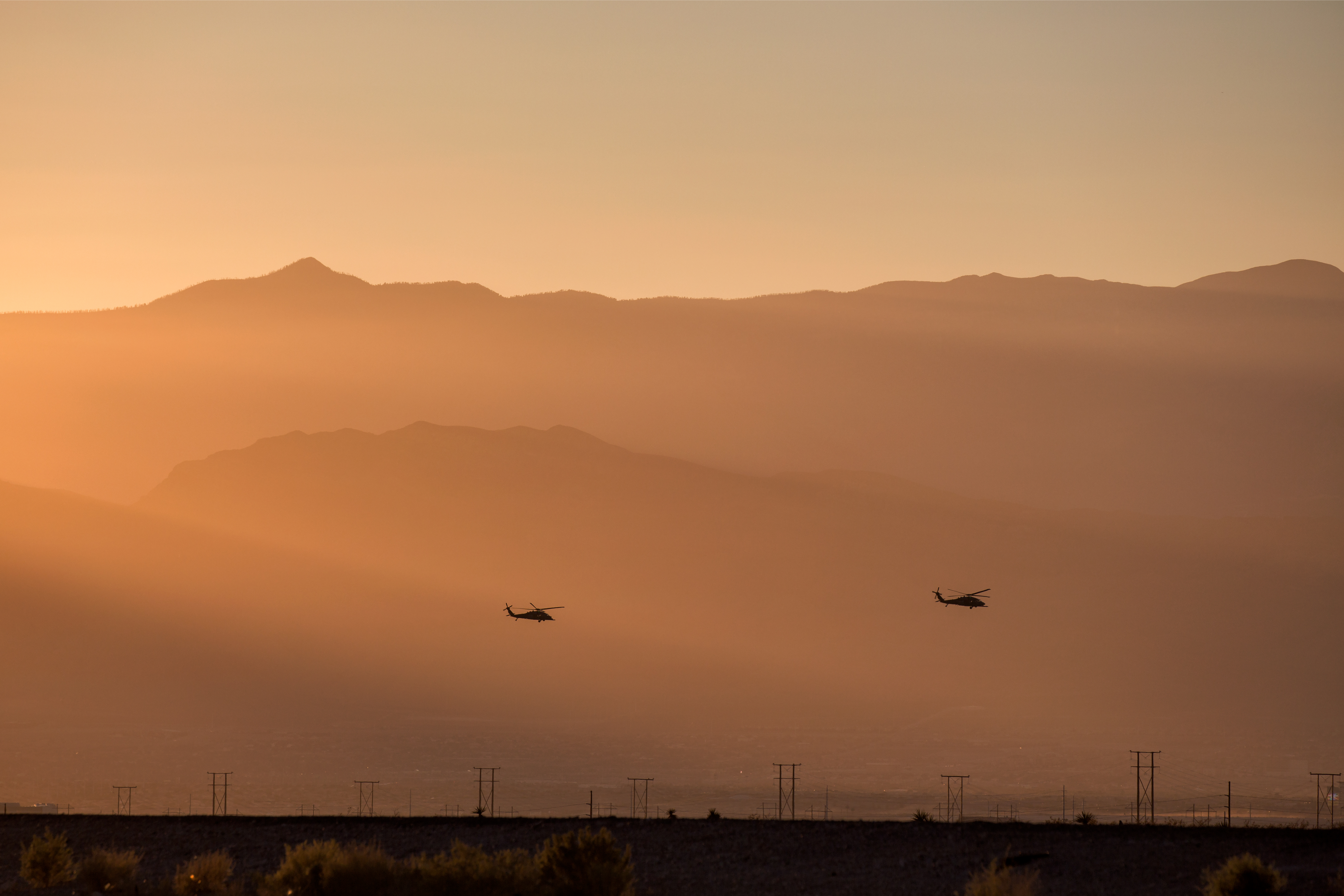 silhouette of helicopter with sunset demonstrating contract jobs middle east